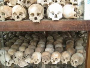 Image:hundreds of human skulls stacked on shelves